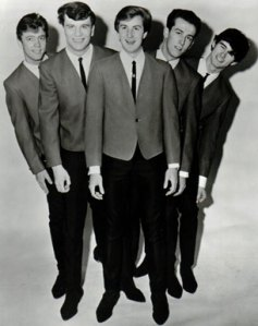 "Jack Ely (center), former Kingsmen vocalist, know for his adequate singing talent and incessant ""life isn't fair"" whining"
