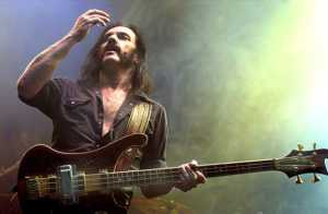 """Lemmy, under the influence of nearly goddamned everything, is suddenly entrance by his """"massive"""" hands."""