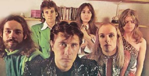 Bryan Ferry poses with members of Grand Funk Railroad and a balding elf