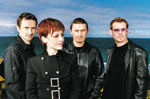 The Cranberries pose for band photo pose #31: lead singer, look to your left; the rest of you, eyes on me...