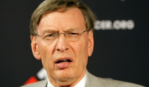 "Bud Selig gives an attractive sportscaster the ""look"""