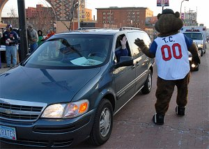 """The Twins mascot, some sort of a large rodent, welcomes the EMT crew to the lower level """"Hard Drinking"""" section"""