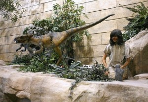"A ""tame"" dinosaur housepet roams the diorama, looking for a toddler to ""play"" with."